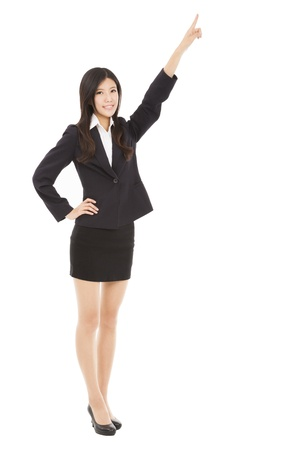 happy businesswoman pointing to copy space Stock Photo - 19811900