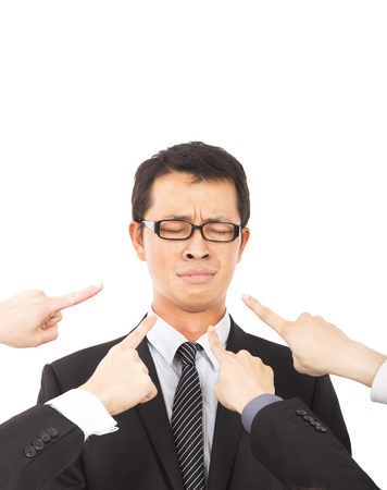 criticize: hands pointing towards sadness businessman