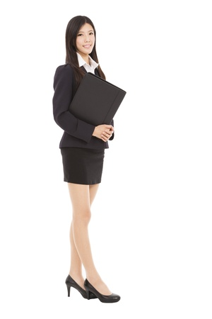 full length smiling businesswoman holding folder Stock Photo - 20020713