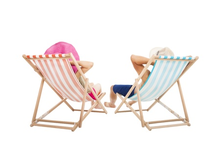 happy Couple sitting on  beach chairs isolated on white photo