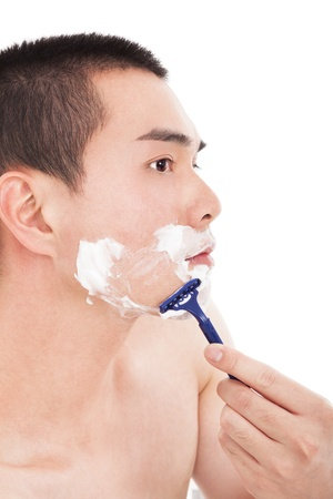 handsome young man with shaving  photo