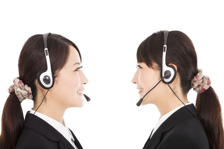 pollinator: side view smiling businesswoman with headphone Stock Photo