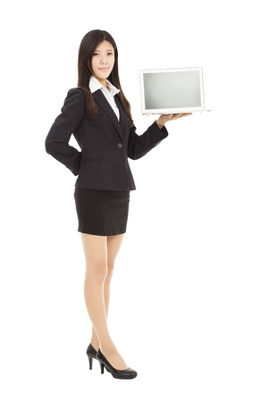 full length of young business woman holding laptop  photo