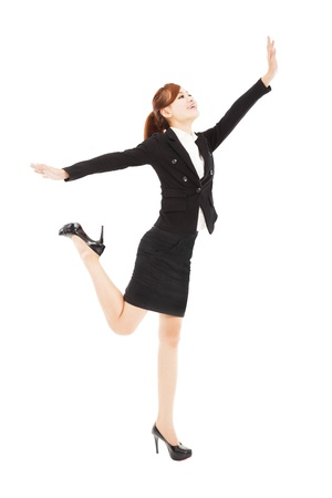 happy businesswoman jumping and try to reach something Stock Photo - 20387776