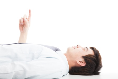 relaxed businessman lie down and pointing up photo