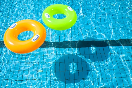 swimming to float: two swimming pool rings with shadow