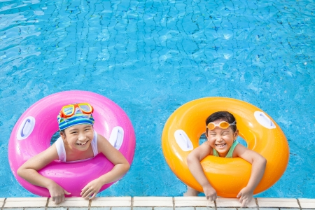 healthy asian family: happy children having fun  in the swimming pool Stock Photo
