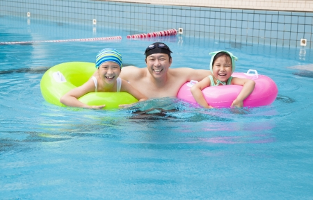 happy family in the swimming pool photo