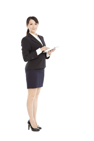 full length beautiful Business woman with tablet pc photo