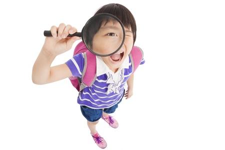 happy school little girl holding magnifier Stock Photo - 21022709