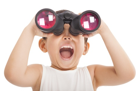 Happy kid with binoculars photo