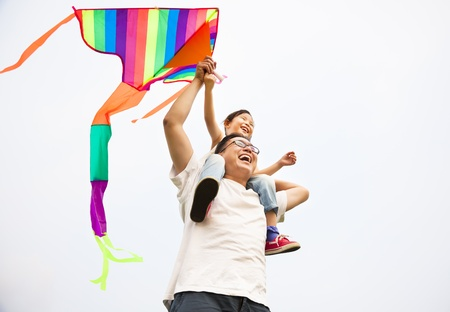 flying a kite: happy family with colorful kite Stock Photo