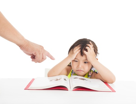 finger pointing to Angry and tired little girl studying photo