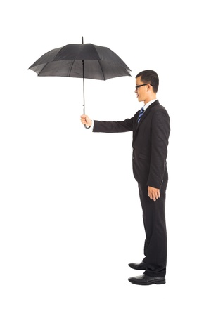 smiling businessman holding umbrella standing photo