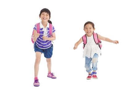 niños chinos: niñas de la escuela feliz corriendo juntos Foto de archivo