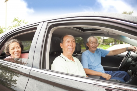 happy seniors enjoying road trip and travel photo