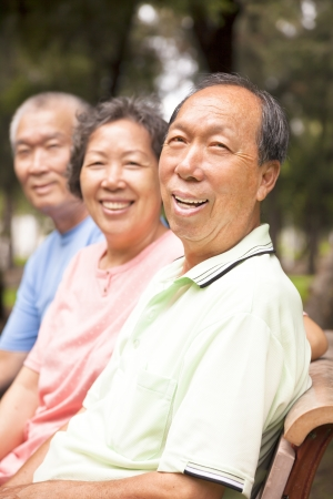 relaxed asian seniors in the park photo