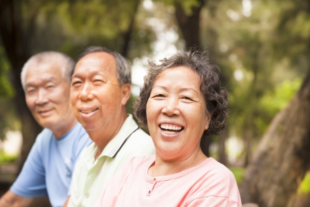 older person: happy asian seniors in the park Stock Photo