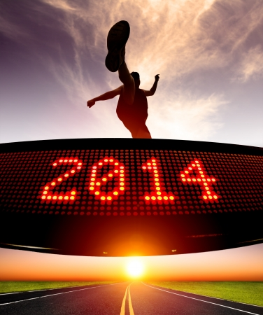 happy new year 2014 runner jumping and crossing over matrix display for celebrating 2014 Stock Photo - 21492411