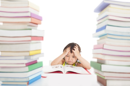 bored face: boring and tired little girl with many books Stock Photo