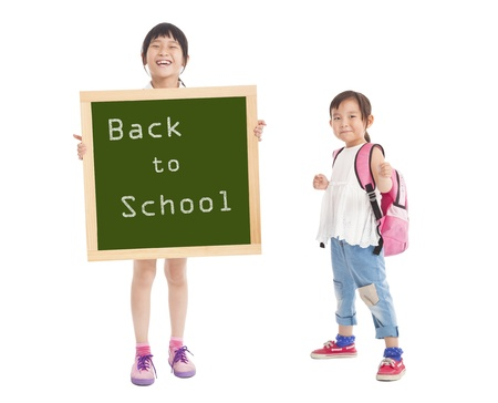 happy little girls showing back to school with chalkboard photo