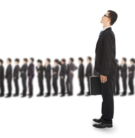 impatient: young business man waiting on the line for interview