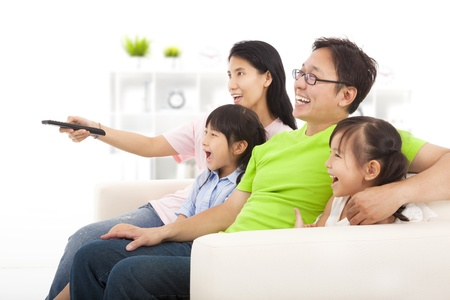 television remote: happy Family watching tv