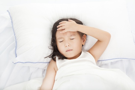 Little girl with illness on the  bed Stock Photo - 21707244