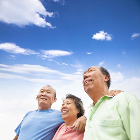 happy asian seniors standing together photo
