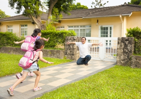 residence: happy father with kids in front of house  Stock Photo