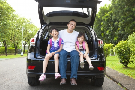 family asia: happy family sitting in the car