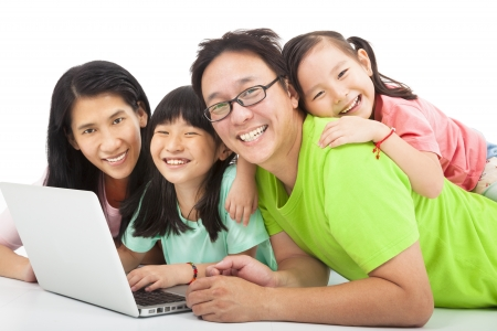 to browse: happy asian family with laptop
