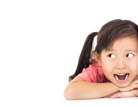 surprised kid: close up surprised face of little girl looking something Stock Photo