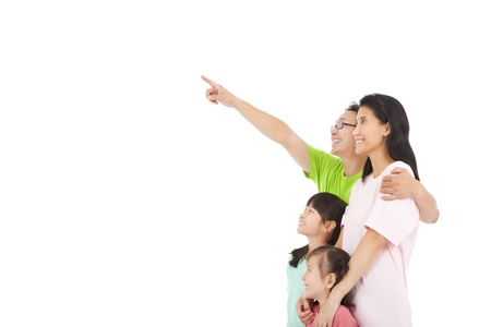 Happy family looking and pointing Stock Photo - 21915623