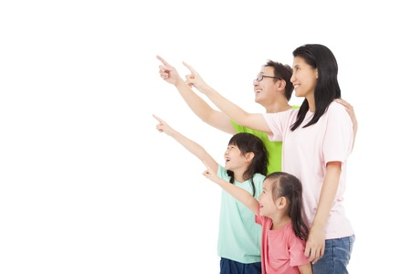 Happy asian family looking and pointing  Stock Photo - 21958307
