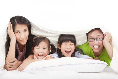 chinese: Happy   family on the bed