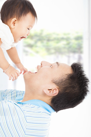 happy father and baby playing photo
