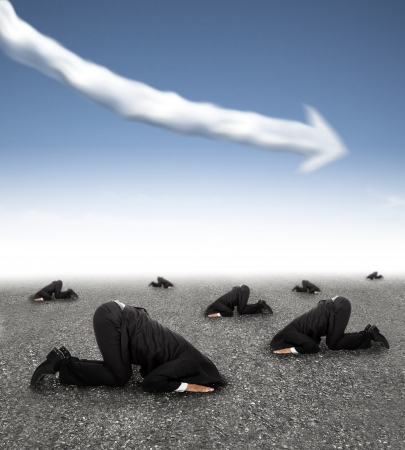 job market: scared businessman hiding on the ground with business graph down concept