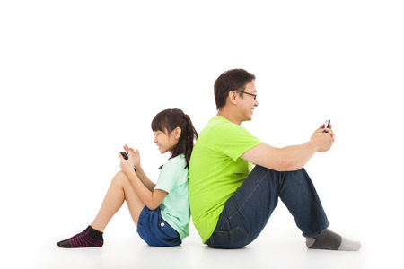 communication between father and daughter by smart phone Stock Photo - 22283259
