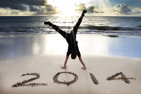 happy new year 2014 on the beach with sunrise Stock Photo - 22483060
