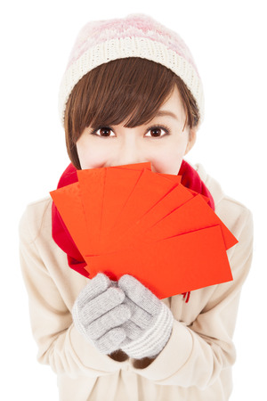 happy asian girl with winter wear and holding  red bag for  chinese new year Stock Photo - 22483735