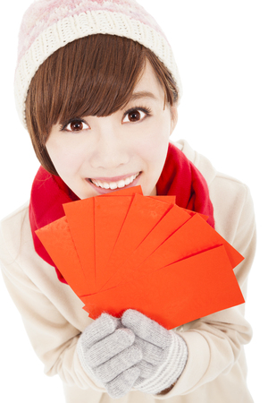 happy girl with winter wear and holding  red bag for  chinese new year Stock Photo - 22483736