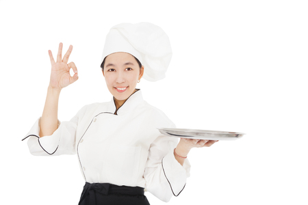 culinary skills: smiling young woman chef with empty food tray