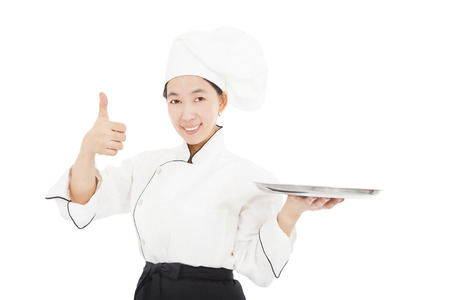 smiling young woman chef with thumb up Stock Photo - 22505212