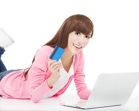 happy woman shopping on the internet with credit card photo