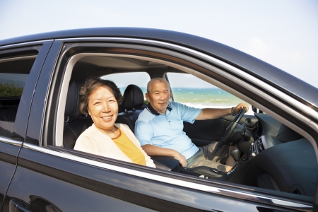 happy seniors couple enjoying road trip  photo