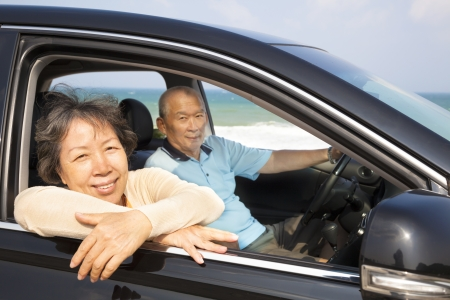 seniors couple enjoying road trip and travel photo