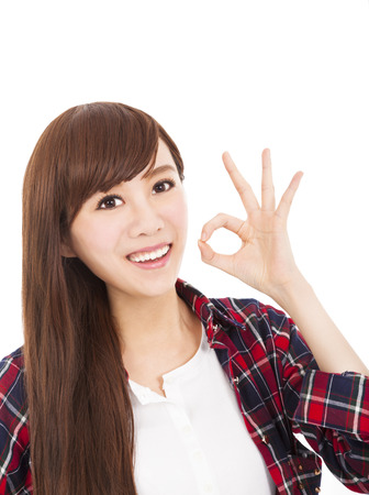 smiling young woman with ok gesture Stock Photo - 22579194