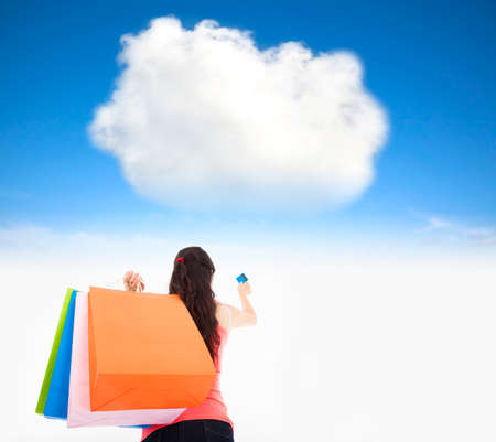 young woman shopping on the internet cloud concept photo