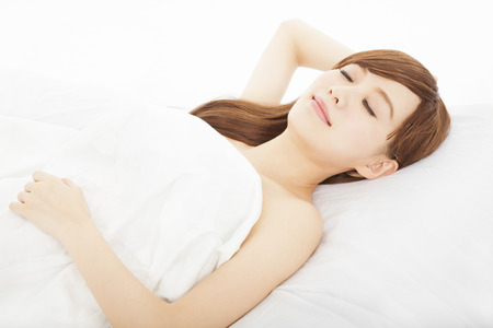 beautiful young woman sleeps in the bedroom photo